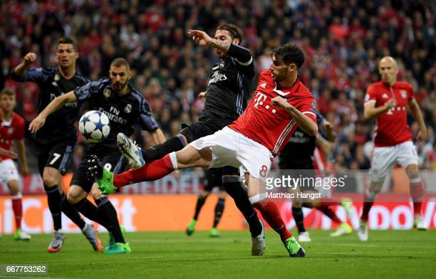 Javi Martinez of Muenchen and Sergio Ramos of Real Madrid battle for the ball during the UEFA Champions League Quarter Final first leg match between...