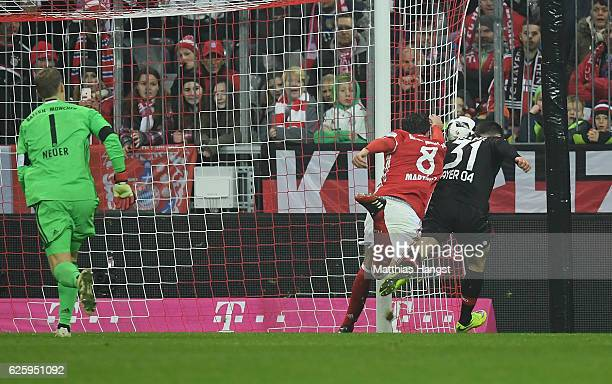 Javi Martinez of Muenchen blocks a ball of Kevin Volland of Leverkusen during the Bundesliga match between Bayern Muenchen and Bayer 04 Leverkusen at...
