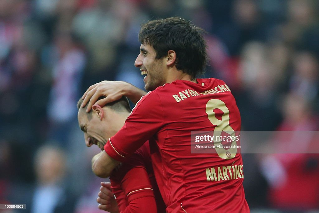 Javi Martinez (R) of Muenchen celebrates scoring the opening goal with his team mate <a gi-track='captionPersonalityLinkClicked' href=/galleries/search?phrase=Franck+Ribery&family=editorial&specificpeople=490869 ng-click='$event.stopPropagation()'>Franck Ribery</a> during the Bundesliga match between FC Bayern Muenchen and Hannover 96 at Allianz Arena on November 24, 2012 in Munich, Germany.