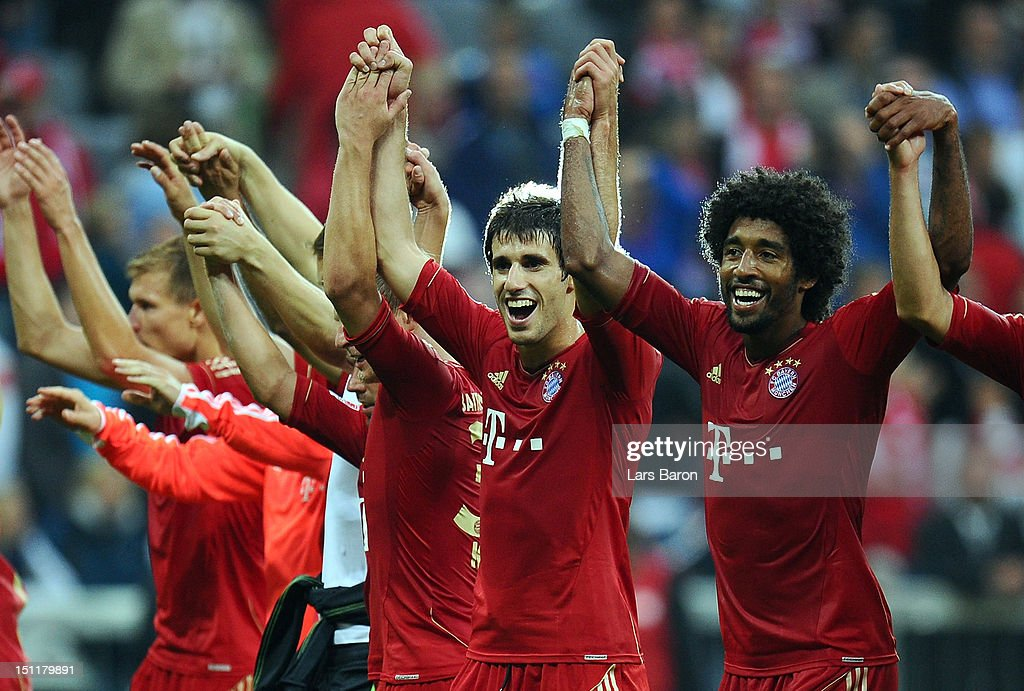 Javi Martinez of Muenchen celebrates with Dante, Claudio Pizarro and other team mates after winning the Bundesliga match between FC Bayern Muenchen and VfB Stuttgart at Allianz Arena on September 2, 2012 in Munich, Germany.