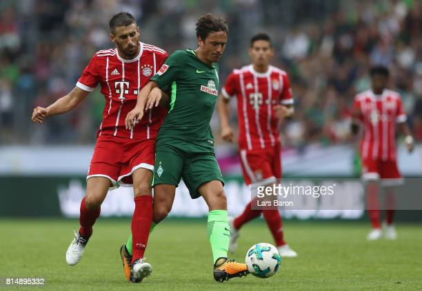 Javi Martinez of Muenchen challenges Thomas Delaney of Bremen during the Telekom Cup 2017 Final between SV Werder Bremen and FC Bayern Muenchen at...