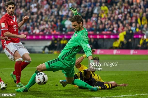 Javi Martinez of Munich Goalkeeper Sven Ulreich of Munich and PierreEmerick Aubameyang of Dortmund battle for the ball during the Bundesliga match...
