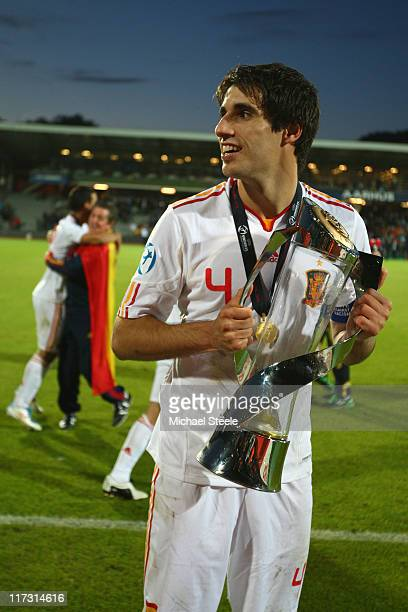 Javi Martinez poses with the winners trophy after his sides 20 victory during the UEFA European Under21 Championship Final match between Spain and...