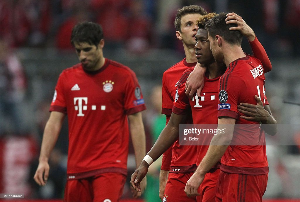 Javi Martinez, Thomas Mueller, David Alaba and Xabi Alonso (L-R) of Bayern Muenchen react after their team's loss of the Champions League semi final second leg match between FC Bayern Muenchen and Club Atletico de Madrid at Allianz Arena on May 3, 2016 in Munich, Germany.