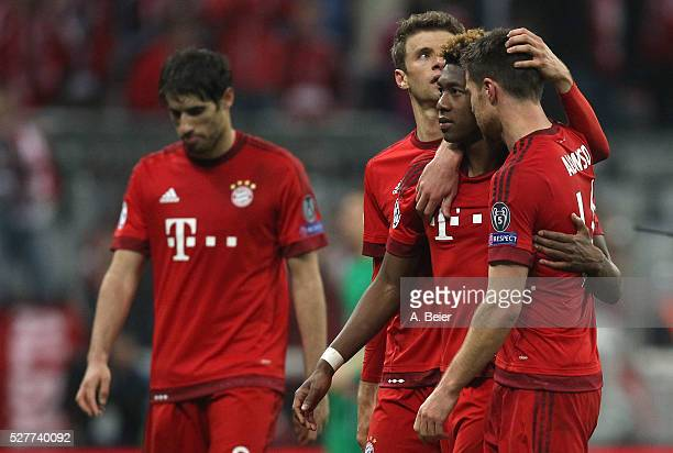 Javi Martinez Thomas Mueller David Alaba and Xabi Alonso of Bayern Muenchen react after their team's loss of the Champions League semi final second...