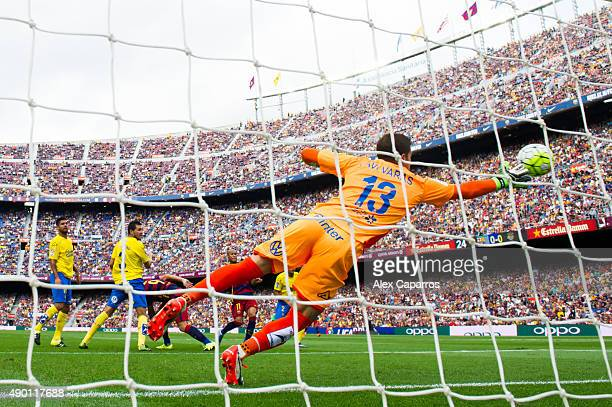 Javi Varas of UD Las Palmas tries to save the ball as Luis Suarez of FC Barcelona scores the opening goal during the La Liga match between FC...