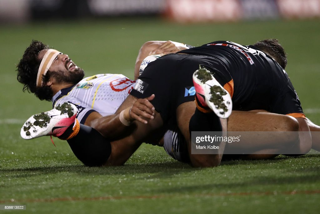 Javid Bowen of the Cowboys grimaces after a tackle during the round 25 NRL match between the Wests Tigers and the North Queensland Cowboys at Campbelltown Sports Stadium on August 25, 2017 in Sydney, Australia.