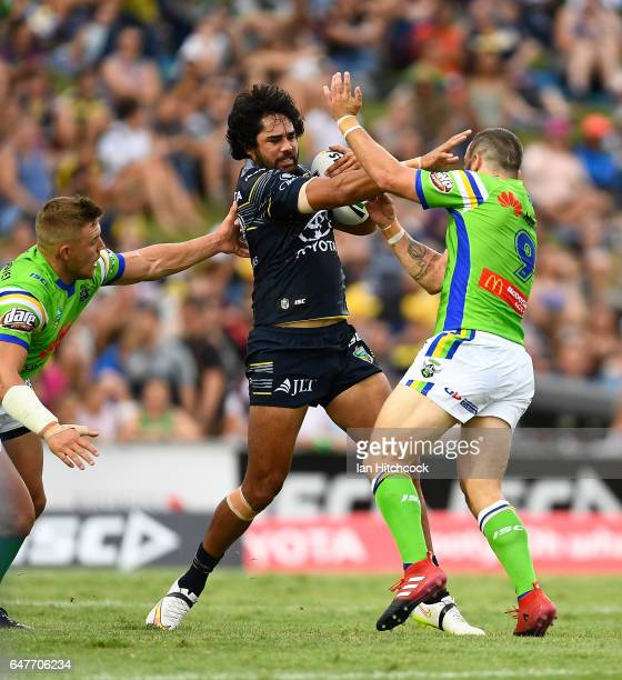 Javid Bowen of the Cowboys is tackled by Josh Hodgson of the Raiders during the round one NRL match between the North Queensland Cowboys and the...