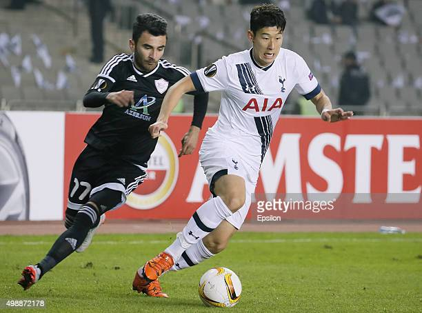 Javid Tagiyev of Qarabag FK hallenged by Son Heungmin of Tottenham Hotspur FC during the UEFA Europe League match between Qarabag FK and Tottenham...