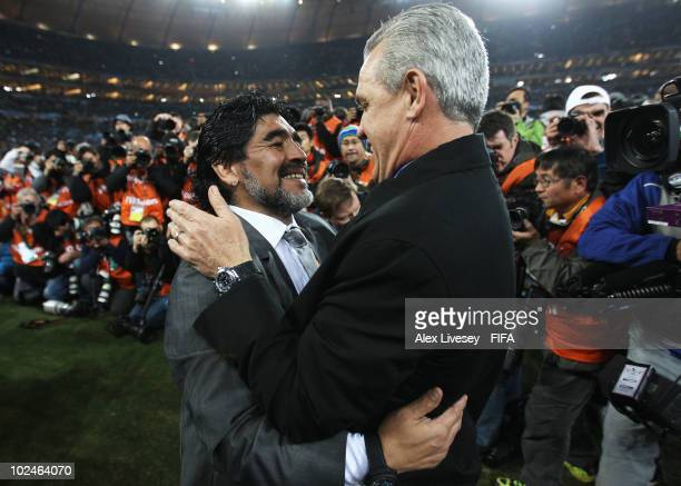 Javier Aguirre head coach of Mexico greets Diego Maradona head coach of Argentina during the 2010 FIFA World Cup South Africa Round of Sixteen match...