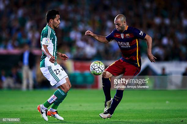 Javier Alejandro Mascherano of FC Barcelona competes for the ball with Petros Matheus of Real Betis Balompie during the La Liga match between Real...