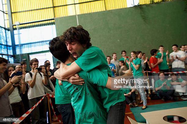 Javier Anton hugs his friend Carlos Hucha as he wins the sumo robots contest during the Cybertech robotics competition at the the School of...
