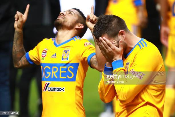 Javier Aquino and Andre Pierre Gignac of Tigres celebrate after winning the second leg of the Torneo Apertura 2017 Liga MX final between Monterrey...
