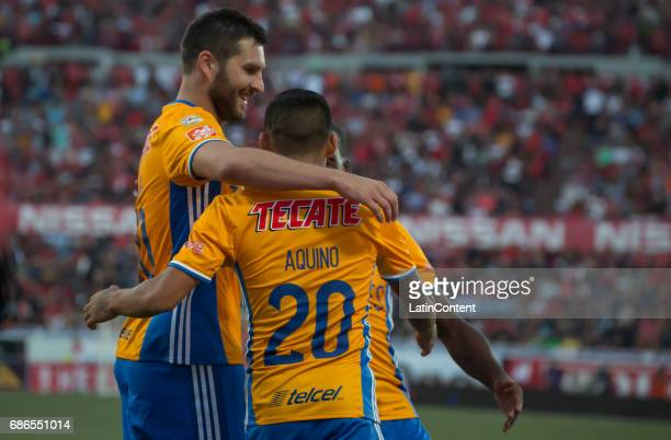 Javier Aquino celebrates with Andre Pierre Gignac after scoring his team's first goal during the semi finals second leg match between Tijuana and...