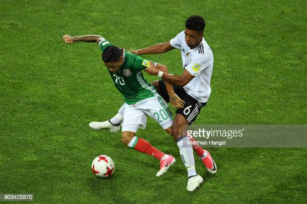 Javier Aquino of Mexico controls the ball under pressure of Benjamin Henrichs of Germany during the FIFA Confederations Cup Russia 2017 SemiFinal...