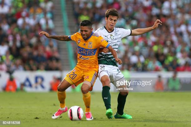Javier Aquino of Tigres and Ulises Rivas of Santos fights for the ball during a match between Santos against Tigres in the Apertura Tournament 2017...