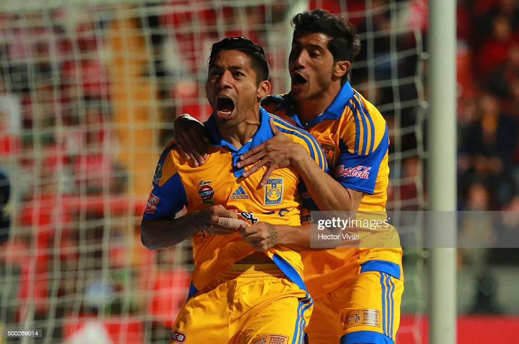 <a gi-track='captionPersonalityLinkClicked' href=/galleries/search?phrase=Javier+Aquino&family=editorial&specificpeople=7218711 ng-click='$event.stopPropagation()'>Javier Aquino</a> of Tigres celebrate with Damian Alvarez after scoring the first goal of his team during the semifinals second leg match between Toluca and Tigres UANL as part of the Apertura 2015 Liga MX at Nemesio Diez Stadium on December 06, 2015 in Monterrey, Mexico.