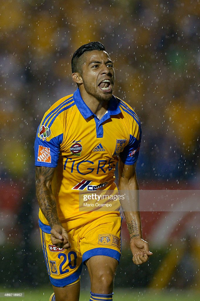 <a gi-track='captionPersonalityLinkClicked' href=/galleries/search?phrase=Javier+Aquino&family=editorial&specificpeople=7218711 ng-click='$event.stopPropagation()'>Javier Aquino</a> of Tigres celebrates after scoring his team's first goal during a 9th round match between Tigres UANL and Monterrey as part of the Apertura 2015 Liga MX at Universitario Stadium on September 19, 2015 in Monterrey, Mexico.