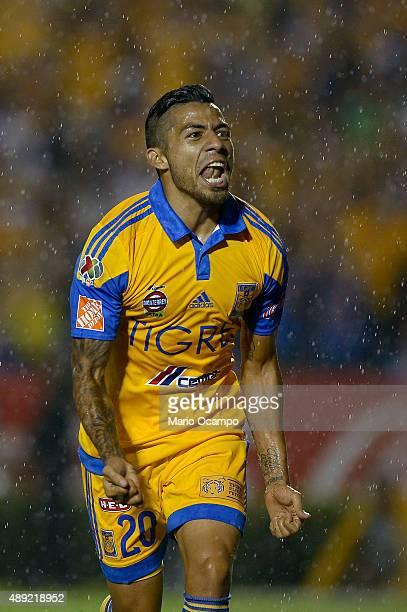 Javier Aquino of Tigres celebrates after scoring his team's first goal during a 9th round match between Tigres UANL and Monterrey as part of the...