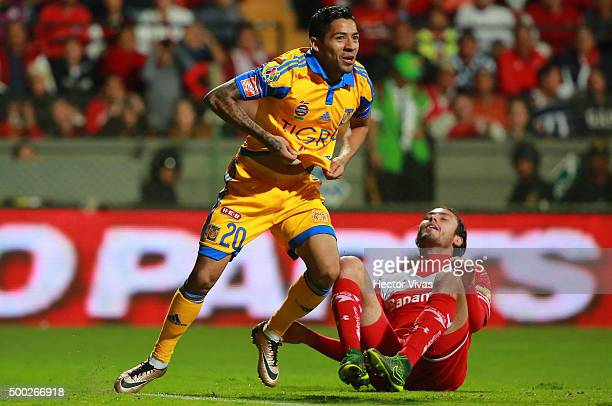 Javier Aquino of Tigres celebrates after scoring the first goal of his team during the semifinals second leg match between Toluca and Tigres UANL as...