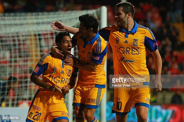 Javier Aquino of Tigres celebrates with teammates after scoring the first goal of his team during the semifinals second leg match between Toluca and...