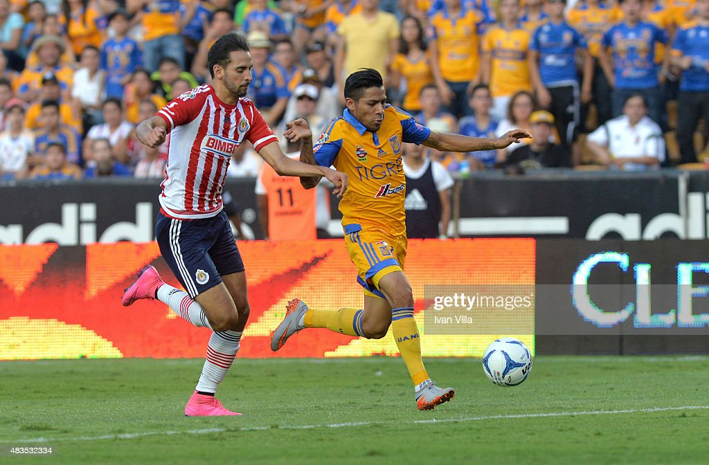 <a gi-track='captionPersonalityLinkClicked' href=/galleries/search?phrase=Javier+Aquino&family=editorial&specificpeople=7218711 ng-click='$event.stopPropagation()'>Javier Aquino</a> of Tigres competes for the ball with Edwin Hernandez of Chivas during a 3rd round match between Tigres UANL and Chivas as part of the Apertura 2015 Liga MX at Jalisco Stadium on August 09, 2015 in Monterrey, Mexico.