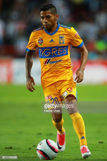 Javier Aquino of Tigres drives the ball during the 4th round match between Pachuca and Tigres UANL as part of the Torneo Apertura 2017 Liga MX at...