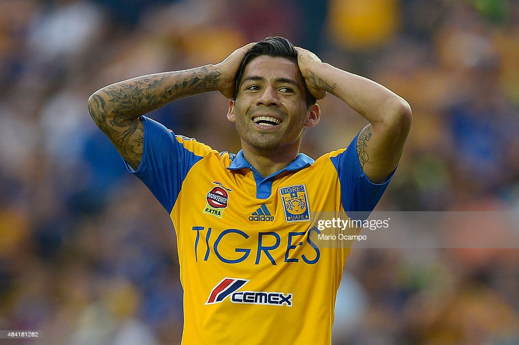<a gi-track='captionPersonalityLinkClicked' href=/galleries/search?phrase=Javier+Aquino&family=editorial&specificpeople=7218711 ng-click='$event.stopPropagation()'>Javier Aquino</a> of Tigres reacts during a 5th round match between Tigres UANL and Chiapas as part of the Apertura 2015 Liga MX at Universitario Stadium on August 15, 2015 in Monterrey, Mexico.