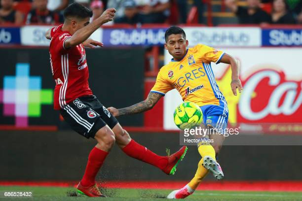 Javier Aquino of Tigres shoots to score the first goal of his team during the semi final second leg match between Tijuana and Tigres UANL as part of...