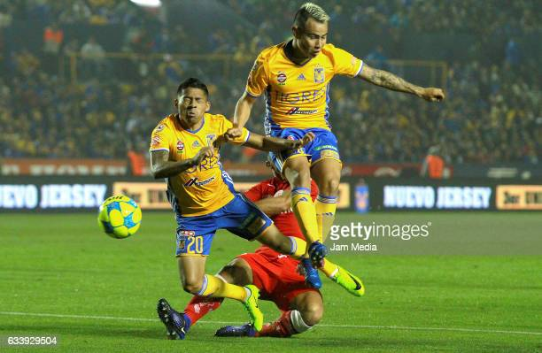 Javier Aquino of Tigres UANL and Lucas Zelarayan fight for the ball during during the 5th round match between Tigres and Toluca as part of the Torneo...