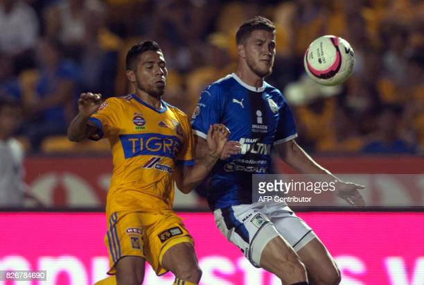 Javier Aquino of Tigres vies for the ball with Hiram Mier of Queretaro during a Mexican Apertura 2017 tournament football match at the Universitario...