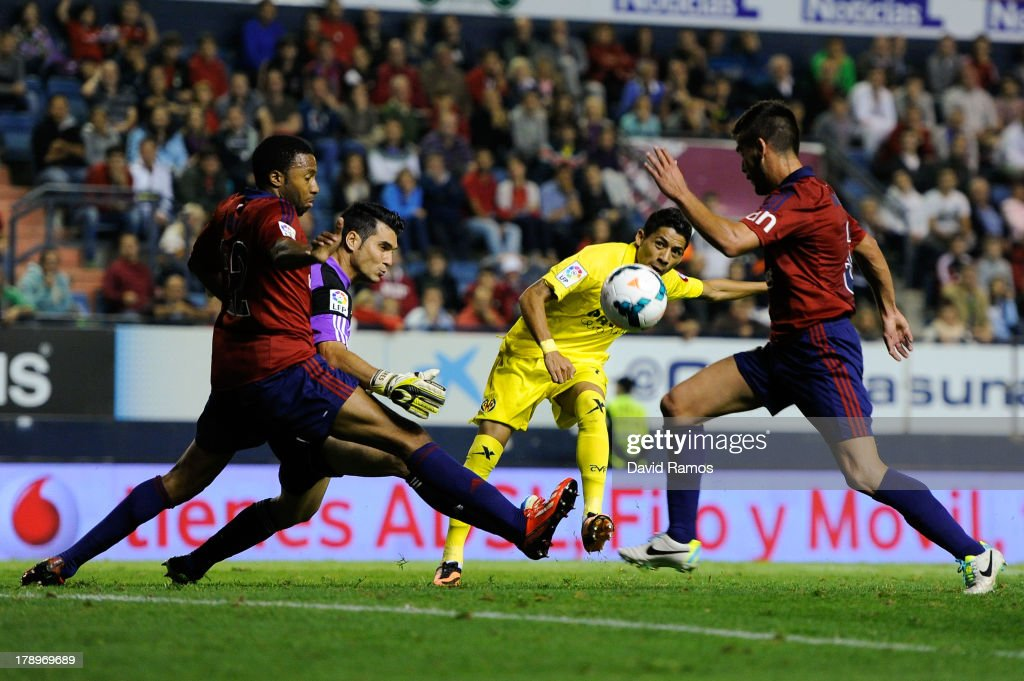 <a gi-track='captionPersonalityLinkClicked' href=/galleries/search?phrase=Javier+Aquino&family=editorial&specificpeople=7218711 ng-click='$event.stopPropagation()'>Javier Aquino</a> of Villarreal CF scores his team's second goal during the La Liga match between CA Osasuna and Villareal CF at El Sadar Stadium on August 31, 2013 in Pamplona, Spain.