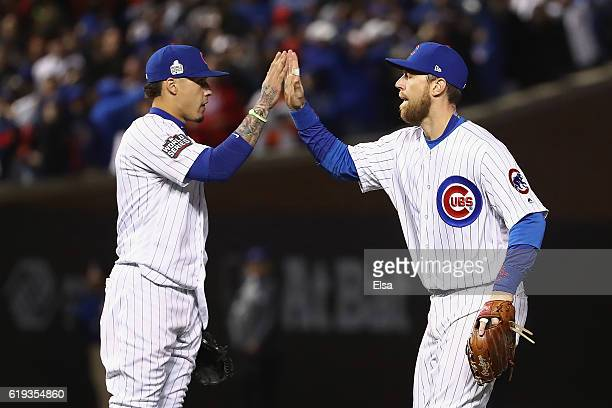 Javier Baez and Ben Zobrist of the Chicago Cubs celebrate after beating the Cleveland Indians 32 in Game Five of the 2016 World Series at Wrigley...