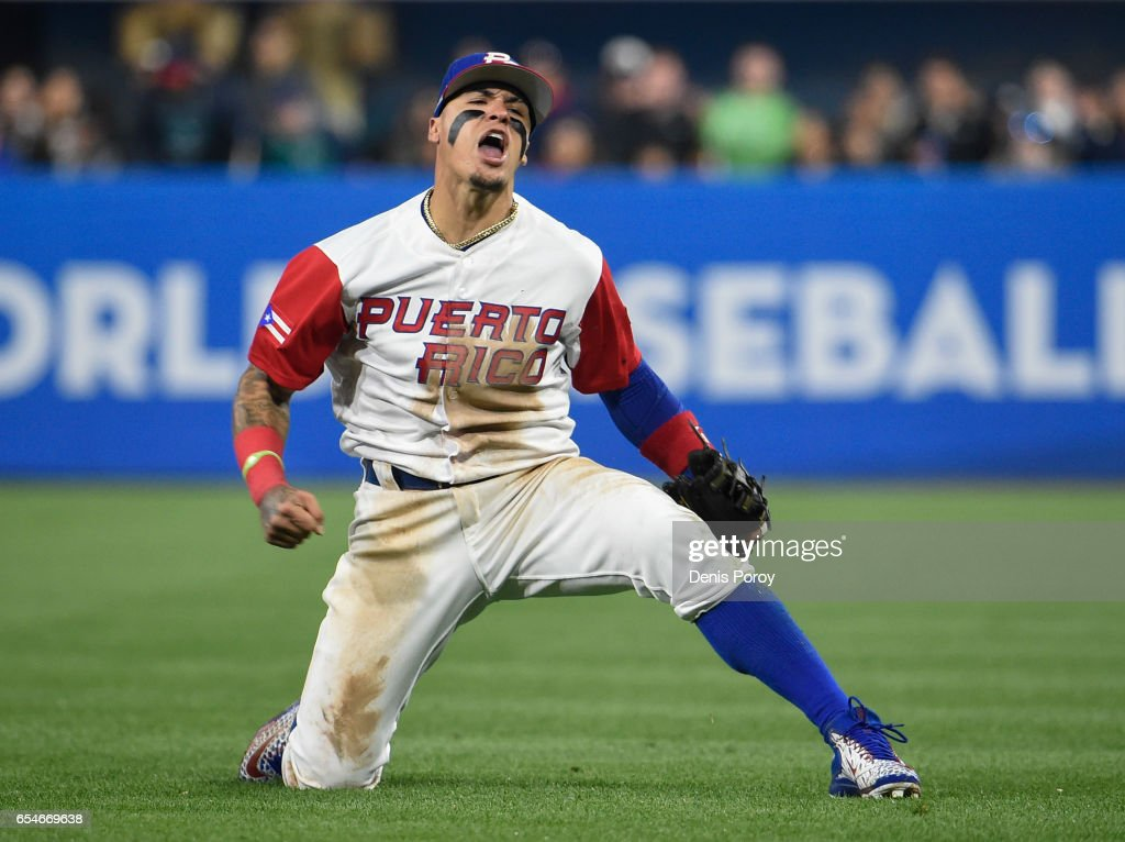 Javier Baez #9 of Puerto Rico reacts after getting the out on Eric Hosmer #35 of the United States during the sixth inning of the World Baseball Classic Pool F Game Four between the United States and Puerto Rico at PETCO Park on March 17, 2017 in San Diego, California.