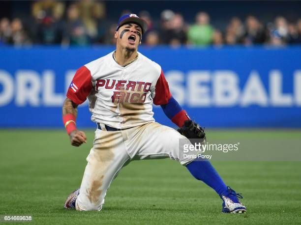 Javier Baez of Puerto Rico reacts after getting the out on Eric Hosmer of the United States during the sixth inning of the World Baseball Classic...