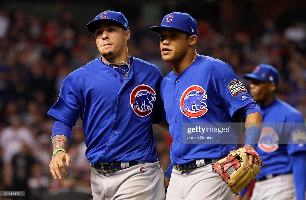 Javier Baez #9 of the Chicago Cubs and Addison Russell #27 react after the eighth inning against the Cleveland Indians in Game Six of the 2016 World Series at Progressive Field on November 1, 2016 in Cleveland, Ohio.