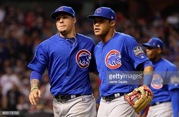 Javier Baez of the Chicago Cubs and Addison Russell react after the eighth inning against the Cleveland Indians in Game Six of the 2016 World Series...