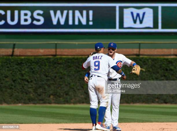 Javier Baez of the Chicago Cubs and Ian Happ celebrate their win against the Toronto Blue Jays on August 18 2017 at Wrigley Field in Chicago Illinois...