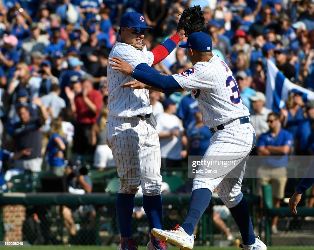 Javier Baez (L) of the Chicago Cubs and Jon Jay #30 celebrate their win against the Toronto Blue Jays on August 18, 2017 at Wrigley Field in Chicago, Illinois. The Cubs defeated the Blue Jays 7-4.