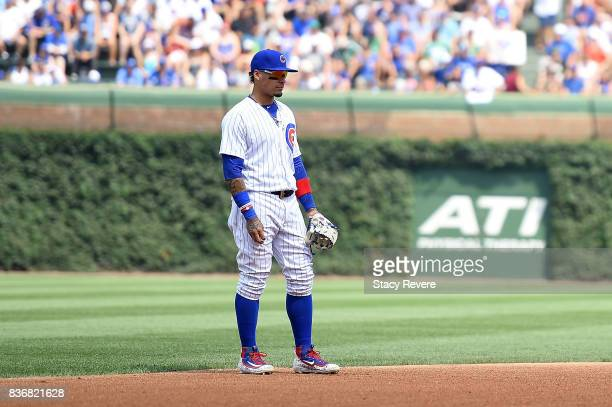 Javier Baez of the Chicago Cubs anticipates a pitch during a game against the Toronto Blue Jays at Wrigley Field on August 20 2017 in Chicago...