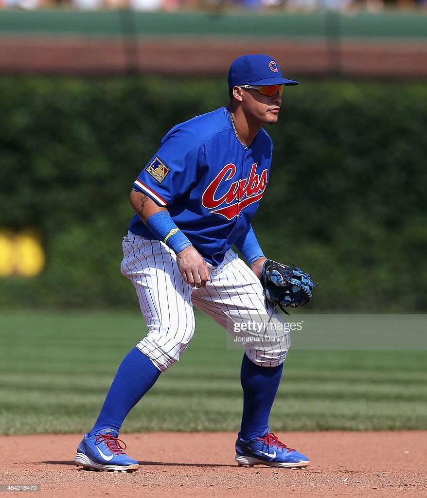 Javier Baez #9 of the Chicago Cubs awaits the pitch against the Baltimore Orioles at Wrigley Field on August 24, 2014 in Chicago, Illinois. The Cubs defeated the Orioles 2-1.