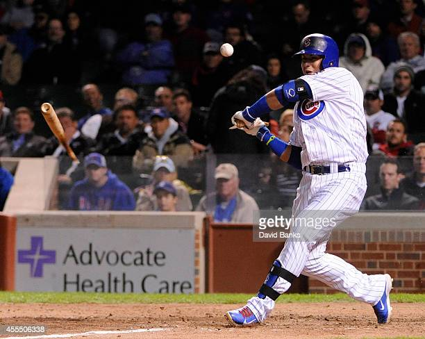 Javier Baez of the Chicago Cubs breaks his bat against the Cincinnati Reds during the eighth inning on September 15 2014 at Wrigley Field in Chicago...