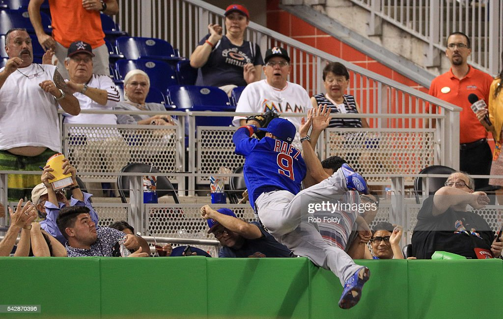 Javier Baez #9 of the Chicago Cubs catches a ball in foul territory during the fourth inning of the game against the Miami Marlins at Marlins Park on June 24, 2016 in Miami, Florida.