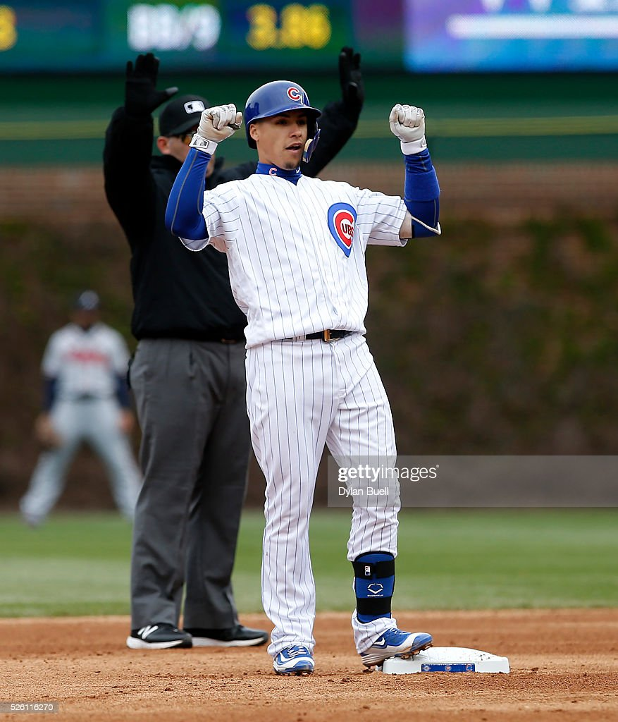 Javier Baez #9 of the Chicago Cubs celebrates after hitting a double in the fifth inning against the Atlanta Braves at Wrigley Field on April 29, 2016 in Chicago, Illinois.