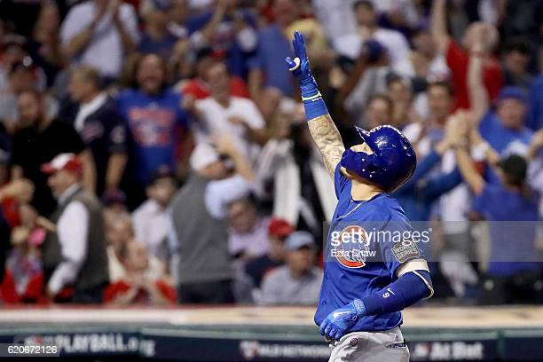Javier Baez of the Chicago Cubs celebrates after hitting a solo home run during the fifth inning against the Cleveland Indians in Game Seven of the...