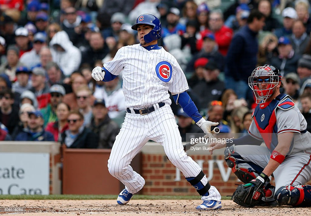 Javier Baez #9 of the Chicago Cubs hits a double in the fifth inning against the Atlanta Braves at Wrigley Field on April 29, 2016 in Chicago, Illinois.