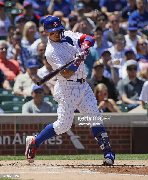 Javier Baez of the Chicago Cubs hits a grand slam home run in the 1st inning against the Cincinnati Reds at Wrigley Field on May 18 2017 in Chicago...