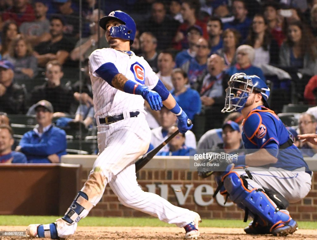 Javier Baez #9 of the Chicago Cubs hits a home run against the New York Mets during the seventh inning on September 13, 2017 at Wrigley Field in Chicago, Illinois.