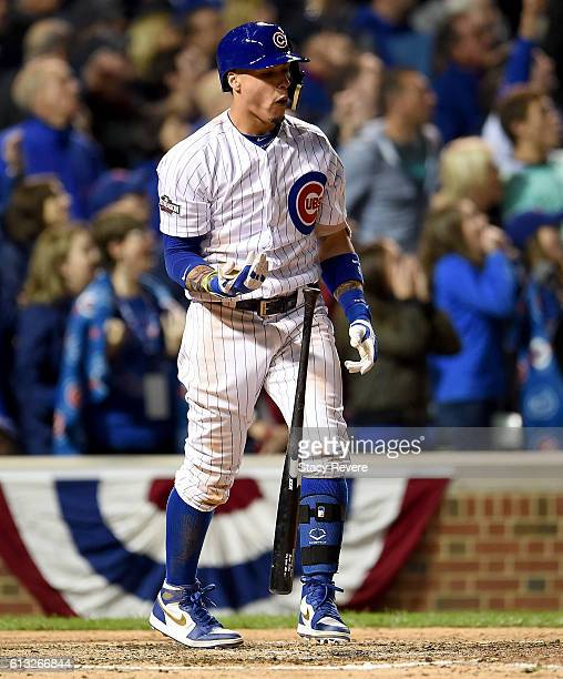 Javier Baez of the Chicago Cubs hits a home run in the eighth inning against the San Francisco Giants at Wrigley Field on October 7 2016 in Chicago...