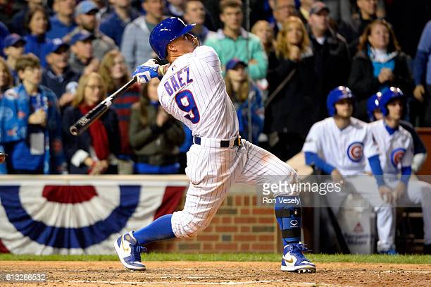 Javier Baez of the Chicago Cubs hits a solo home run in the eighth inning during Game 1 of NLDS against the San Francisco Giants at Wrigley Field on...